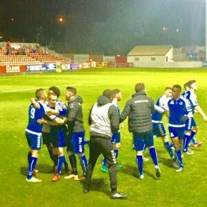 Limerick players celebrate O'Flynn's crucial goal