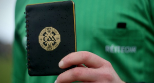 Referee with the black card