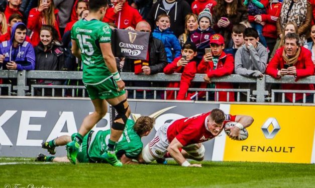 Munster seal top spot with 7 try rout of Connacht