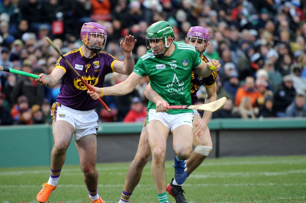 2018 Fenway Hurling Classic, Fenway Park, Boston, USA 18/11/2018 Wexford vs Limerick Limerick's Aaron Gillane with Eoin Moore of Wexford Mandatory Credit ©INPHO/Emily Harney