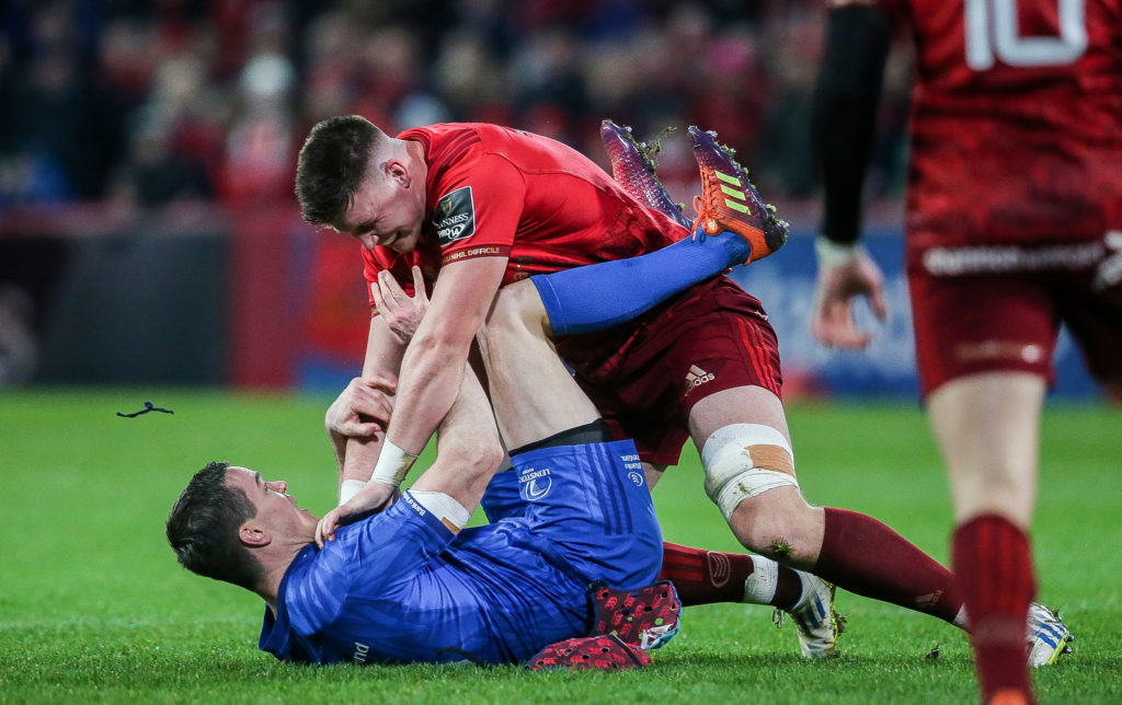 Guinness PRO14, Thomond Park, Limerick 29/12/2018 Munster vs Leinster Leinster's Johnny Sexton and Fineen Wycherley of Munster scuffle off the ball Mandatory Credit ©INPHO/Gary Carr