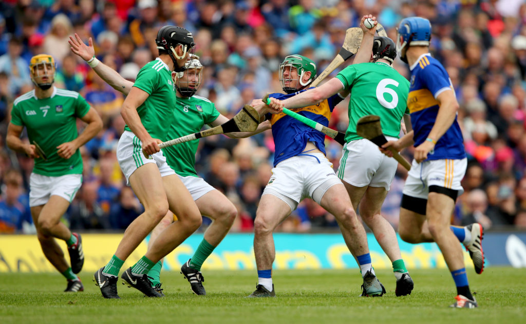 Munster GAA Senior Hurling Championship Final, LIT Gaelic Grounds, Limerick 30/6/2019 Tipperary vs Limerick Limerick's Gearoid Hegarty, Cian Lynch and Declan Hannon tackle John O'Dwyer of Tipperary Mandatory Credit ©INPHO/James Crombie