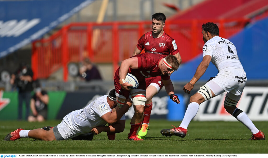 3 April 2021; Gavin Coombes of Munster is tackled by Charlie Faumuina of Toulouse during the Heineken Champions Cup Round of 16 match between Munster and Toulouse at Thomond Park in Limerick. Photo by Ramsey Cardy/Sportsfile