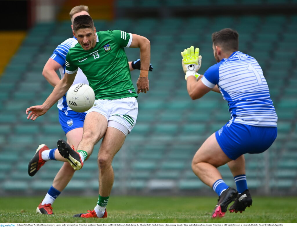 26 June 2021; Danny Neville of Limerick scores a point under pressure from Waterford goalkeeper Paudie Hunt and David Hallihan, behind, during the Munster GAA Football Senior Championship Quarter-Final match between Limerick and Waterford at LIT Gaelic Grounds in Limerick. Photo by Piaras Ó Mídheach/Sportsfile