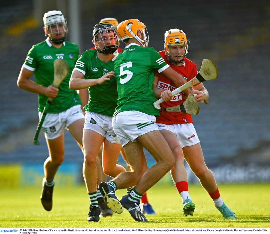 27 July 2021; Rory Sheahan of Cork is tackled by David Fitzgerald of Limerick during the Electric Ireland Munster GAA Minor Hurling Championship Semi-Final match between Limerick and Cork at Semple Stadium in Thurles, Tipperary. Photo by Eóin Noonan/Sportsfile